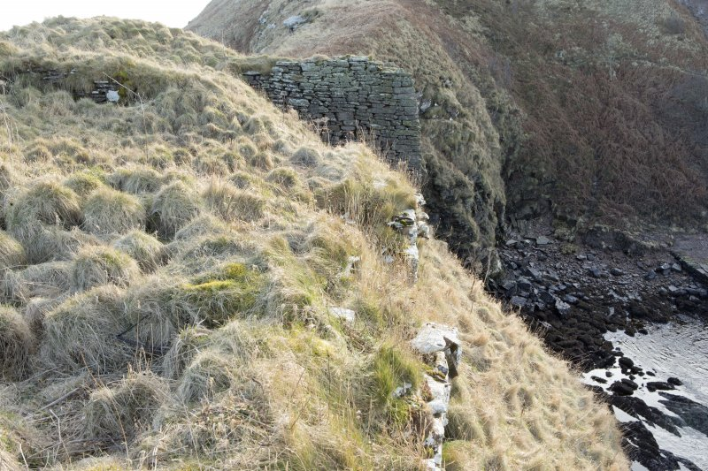 Wall on north-west side of castle and possible buttress projecting from south west side of site, view from north east