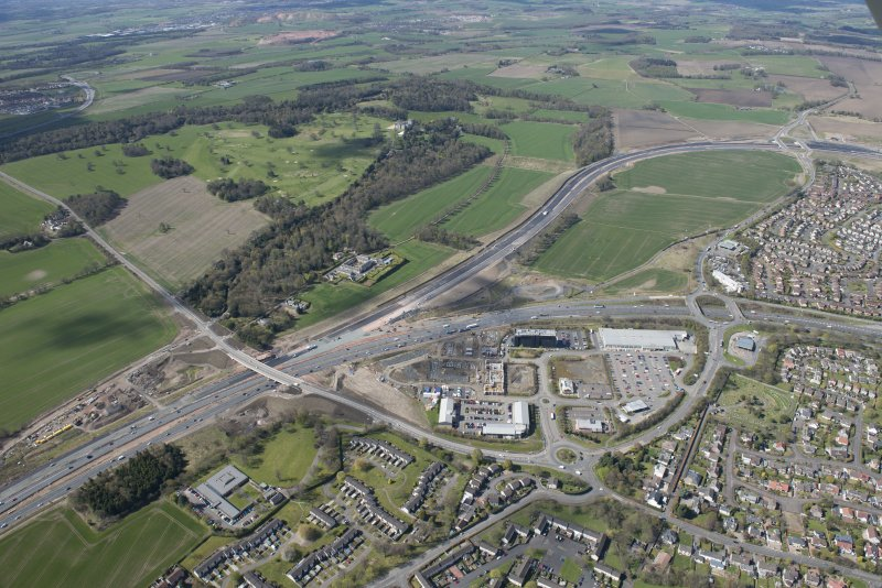 Oblique aerial view of the A90 road junction, road works for the Queensferry Crossing, Dundas Castle Golf Course and Newbigging Steading, looking WSW.