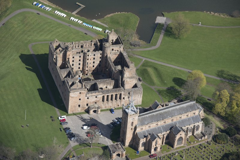 Oblique aerial view of Linlithgow Palace and St Michael's Church, looking NNE.