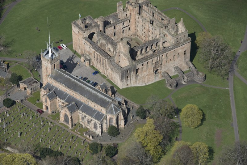 Oblique aerial view of Linlithgow Palace and St Michael's Church, looking NW.