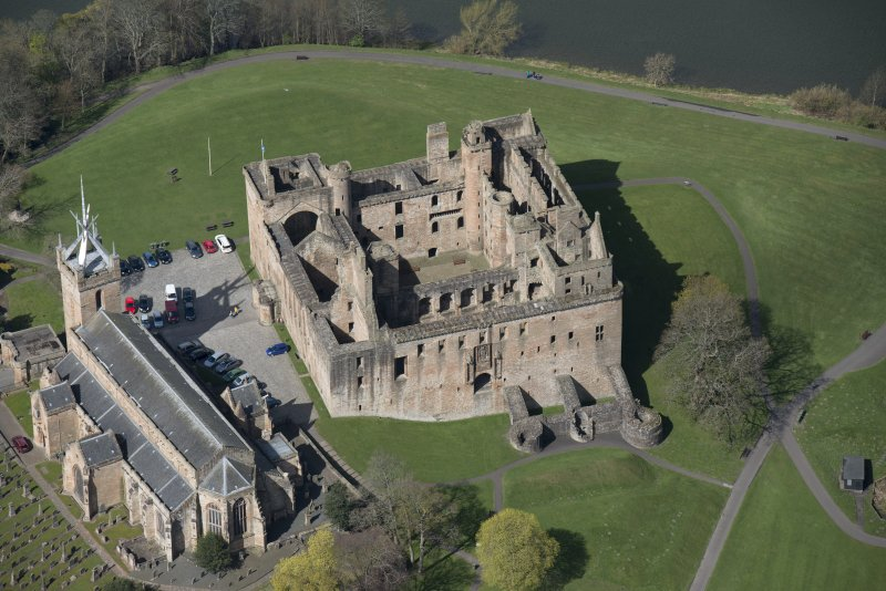 Oblique aerial view of Linlithgow Palace and St Michael's Church, looking WNW.