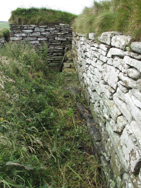North range, east wall, foundation course of earlier structure