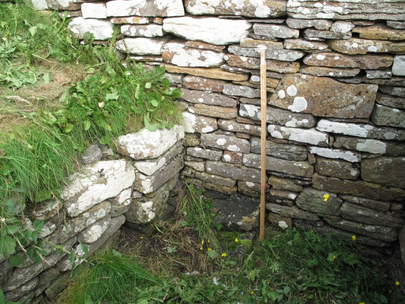 Outbuildings, principal range, south wall, detail of buttress and earlier footings