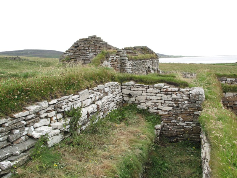 Outbuildings, principal range (left) with buttress and later consolidation. Secondary range (right)