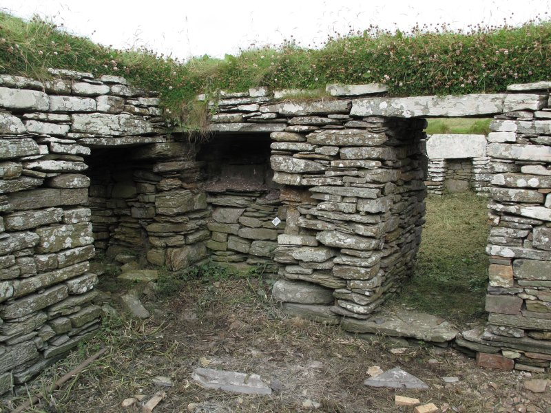 Outbuildings, principal range, east room, N wall. The blocked central opening may have led to a N room, later superceded by another accessed by the right hand opening. The opening on the left leads to the central room in the range.