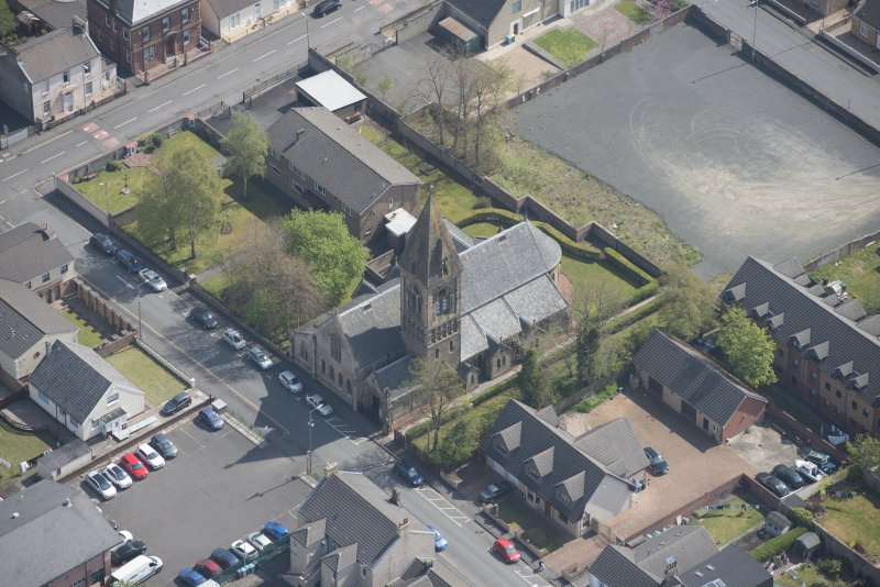 Oblique aerial view of St Ignatius' Catholic Church, looking E.