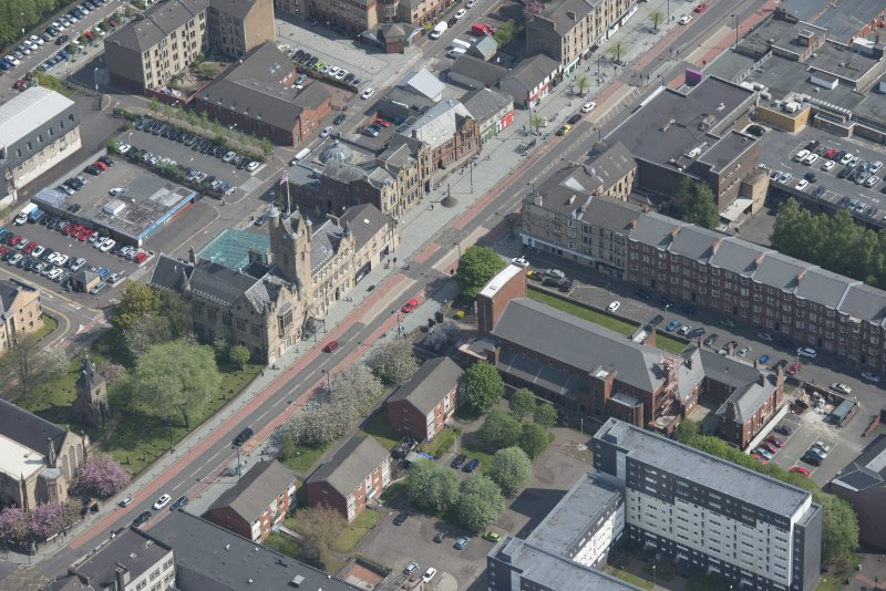Oblique aerial view of St Columbkille's Roman Catholic Church and Rutherglen Town Hall, looking NE.