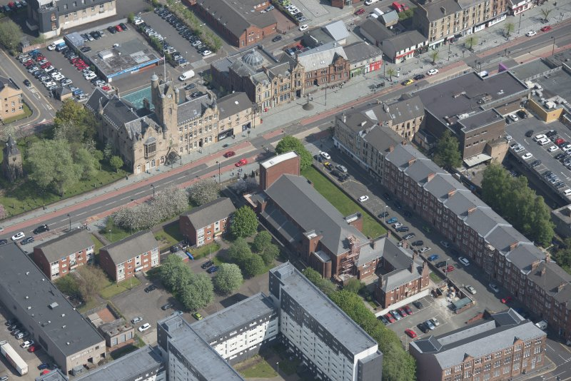 Oblique aerial view of St Columbkille's Roman Catholic Church and Rutherglen Town Hall, looking NNE.