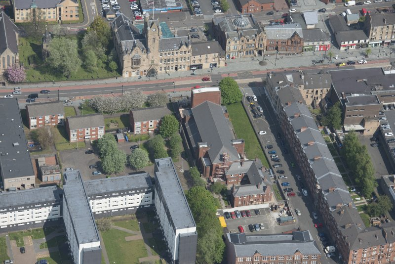 Oblique aerial view of St Columbkille's Roman Catholic Church and Rutherglen Town Hall, looking N.