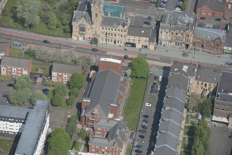 Oblique aerial view of St Columbkille's Roman Catholic Church and Rutherglen Town Hall, looking NNW.