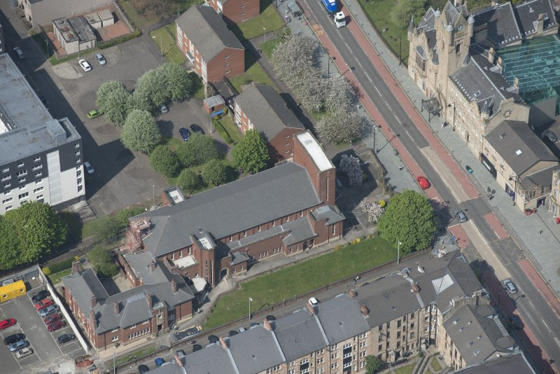 Oblique aerial view of St Columbkille's Roman Catholic Church and Rutherglen Town Hall, looking WNW.