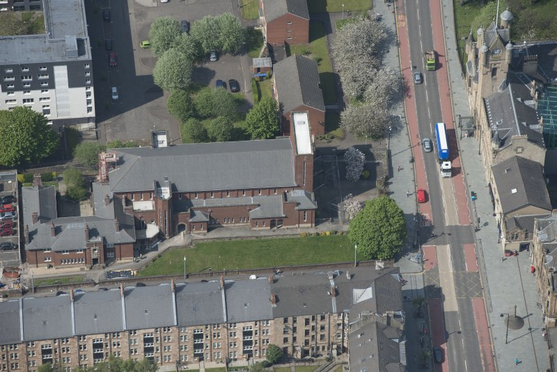 Oblique aerial view of St Columbkille's Roman Catholic Church and Rutherglen Town Hall, looking W.