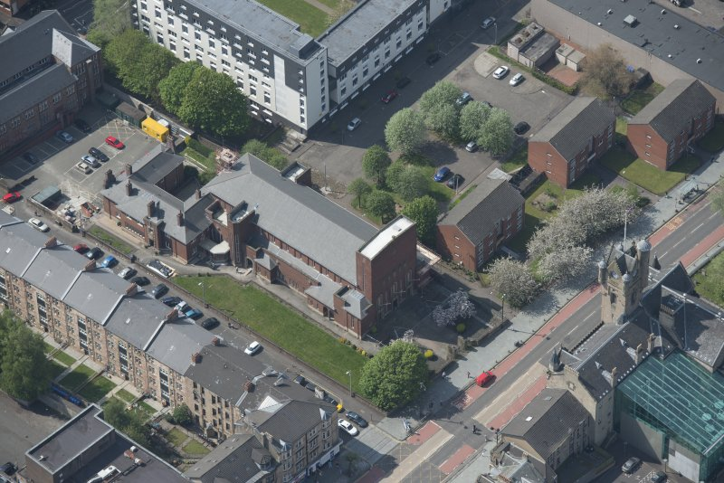 Oblique aerial view of St Columbkille's Roman Catholic Church and Rutherglen Town Hall, looking SW.