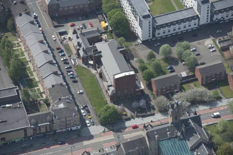 Oblique aerial view of St Columbkille's Roman Catholic Church and Rutherglen Town Hall, looking SSW.