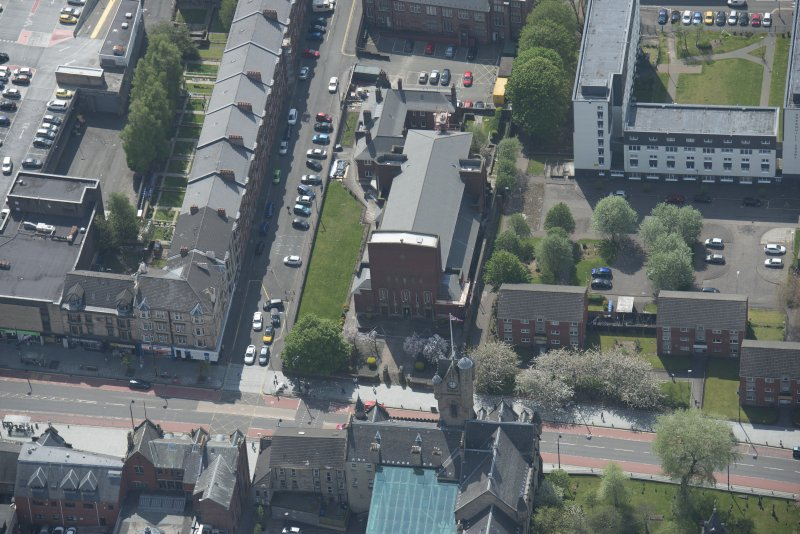 Oblique aerial view of St Columbkille's Roman Catholic Church and Rutherglen Town Hall, looking S.