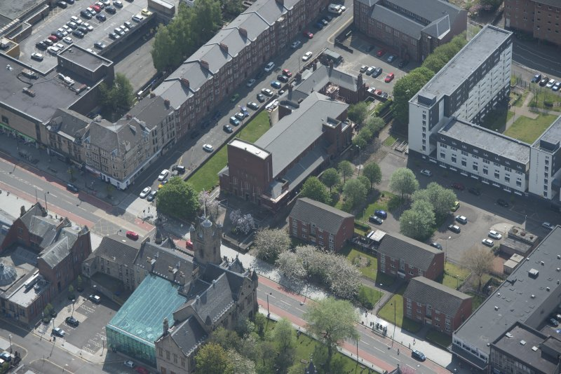 Oblique aerial view of St Columbkille's Roman Catholic Church and Rutherglen Town Hall, looking SSE.