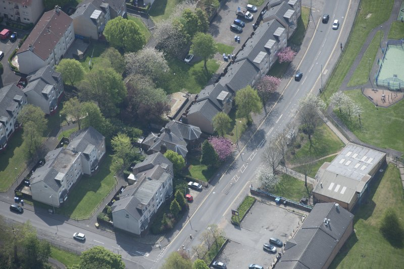 Oblique aerial view of 104 -138, 140 and 142 Balgrayhill Road, looking SSE.