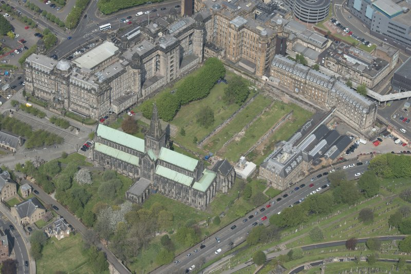 Oblique aerial view of Cathedral of St Mungo Burial Ground and Glasgow Catheral, looking NW.