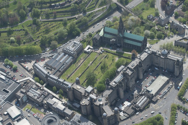 Oblique aerial view of Cathedral of St Mungo Burial Ground, Glasgow Cathedral and the Royal Infirmary, looking SE.