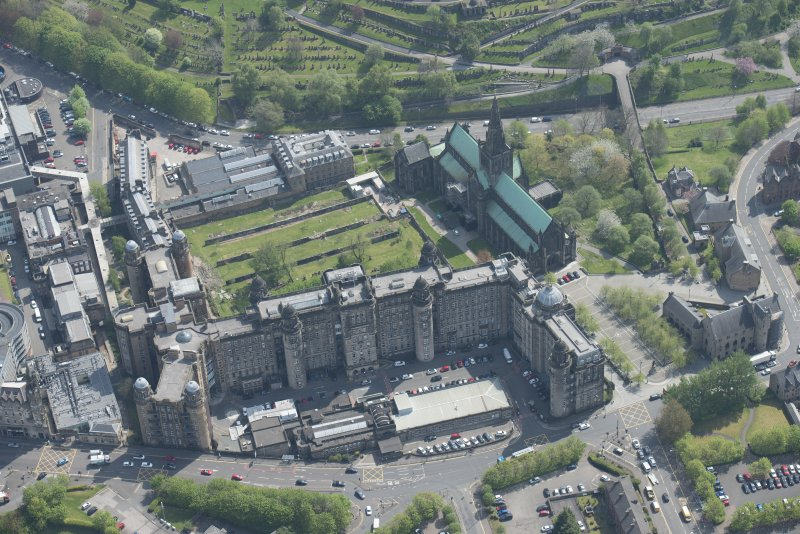 Oblique aerial view of Cathedral of St Mungo Burial Ground, Glasgow Cathedral and the Royal Infirmary, looking E.