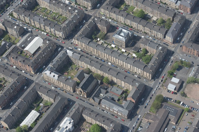 Oblique aerial view of Holy Cross School, Govanhill Public School, Govanhill Public School, Allison Street and Daisy Street, looking NNW.