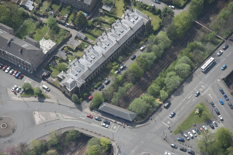 Oblique aerial view of 36 Ibrox Terrace, Strathbungo Station and Moray Place, looking SW.
