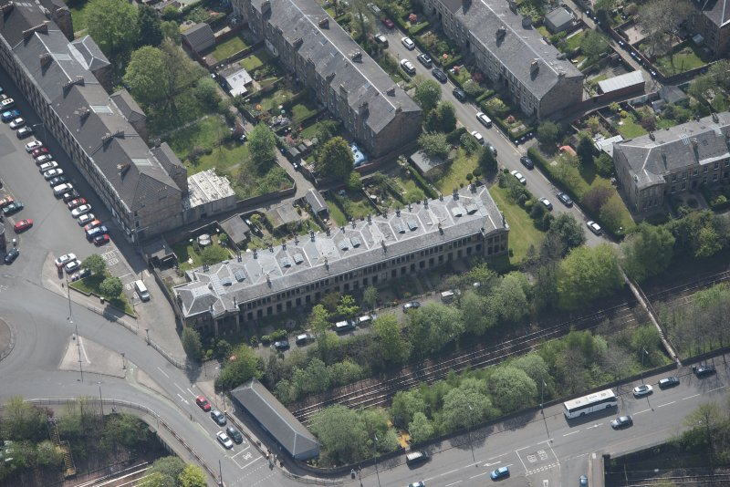 Oblique aerial view of 36 Ibrox Terrace, Strathbungo Station and Moray Place, looking SSE.