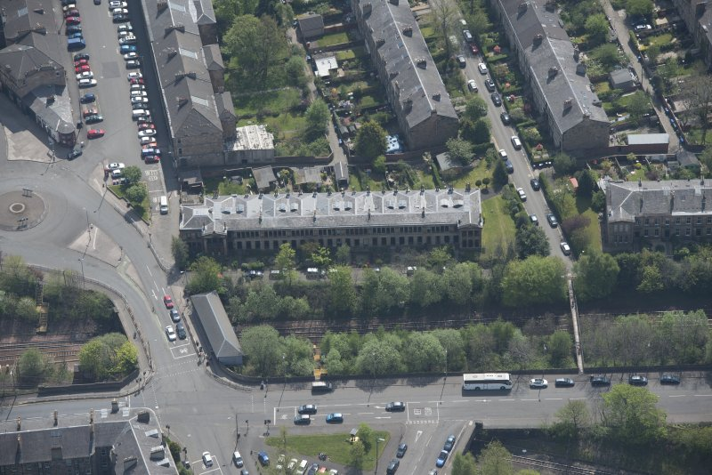 Oblique aerial view of 36 Ibrox Terrace, Strathbungo Station and Moray Place, looking SE.