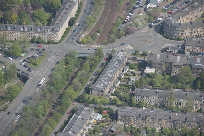 Oblique aerial view of 36 Ibrox Terrace, Strathbungo Station and Moray Place, looking NE.