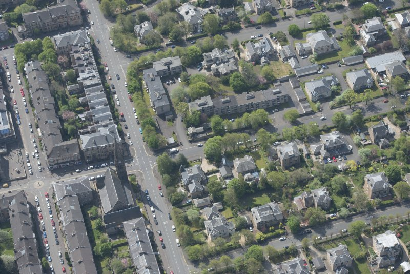 Oblique aerial view of Pollokshields Parish Church, The Knowe villa and lodge, looking SSW.