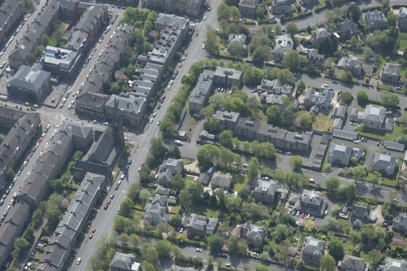Oblique aerial view of Pollokshields Parish Church, The Knowe villa and lodge, looking S.