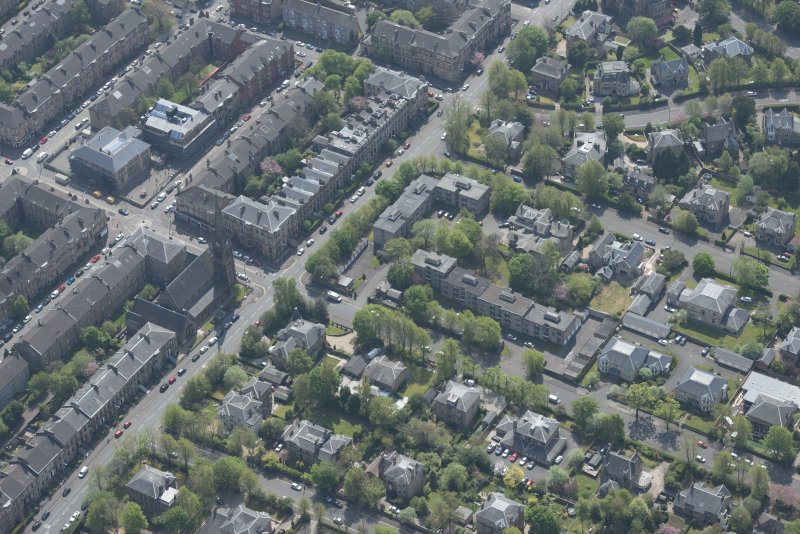 Oblique aerial view of Pollokshields Parish Church, The Knowe villa and lodge, looking SSE.
