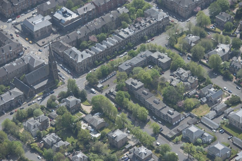 Oblique aerial view of Pollokshields Parish Church, The Knowe villa and lodge, looking SE.