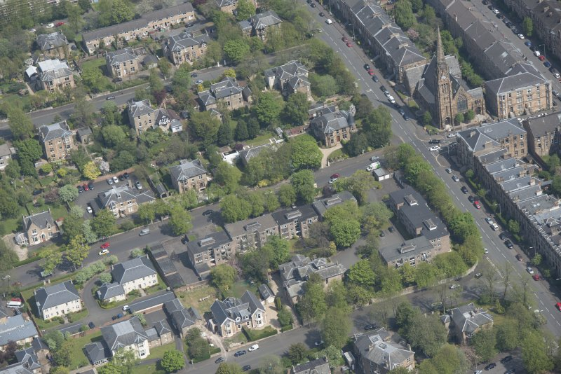 Oblique aerial view of Pollokshields Parish Church, The Knowe villa and lodge, looking ENE.
