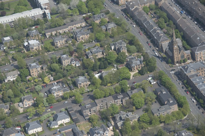 Oblique aerial view of Pollokshields Parish Church, The Knowe villa and lodge, looking NE.