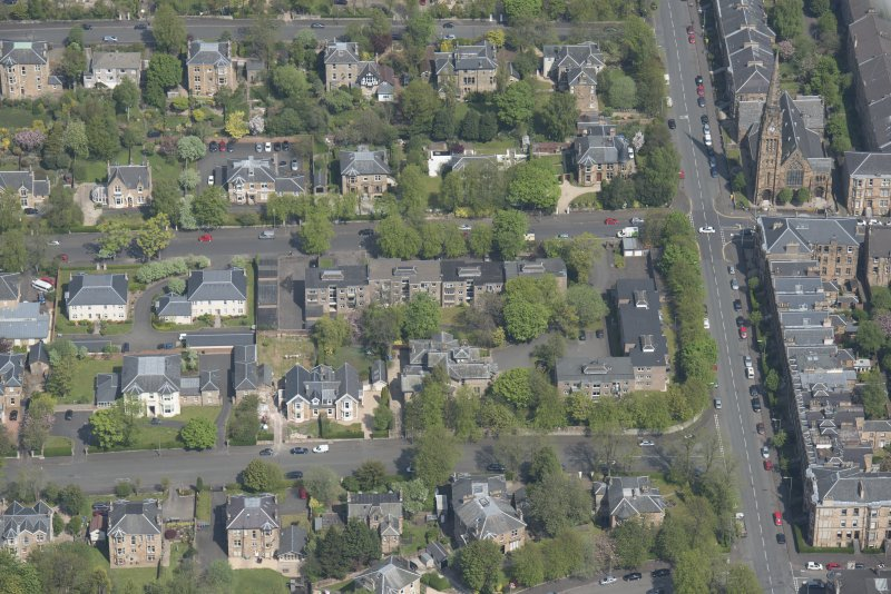 Oblique aerial view of Pollokshields Parish Church, The Knowe villa and lodge, looking NNE.