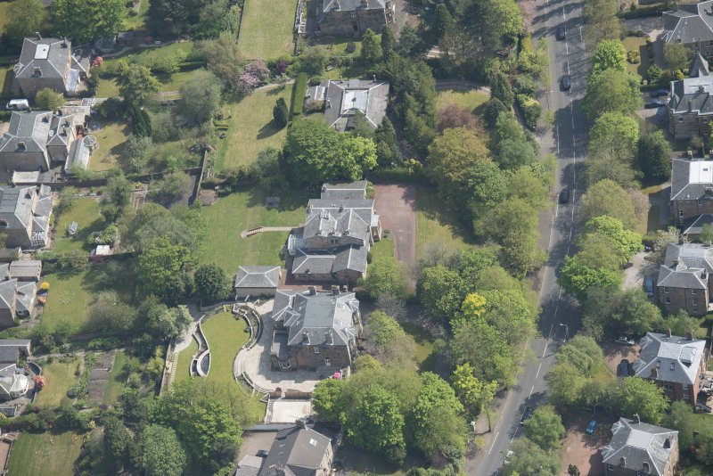 Oblique aerial view of Castlehill and Ellisland villas, looking ESE.