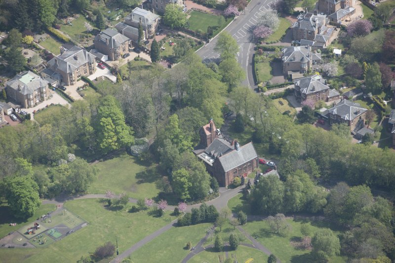 Oblique aerial view of Pollokshields Burgh Hall, looking E.