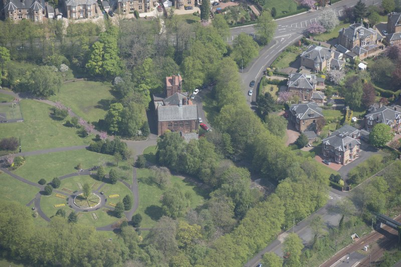 Oblique aerial view of Pollokshields Burgh Hall and Hamilton Fountain, looking NE.