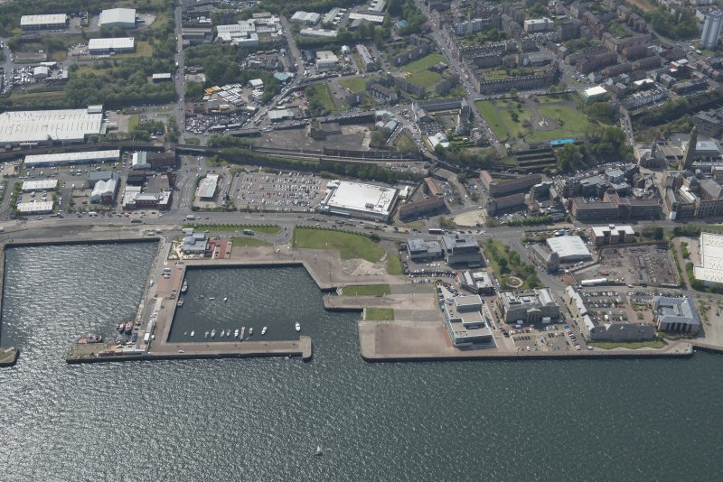 Oblique aerial view of East India Harbour and Custom House Place, looking SW.