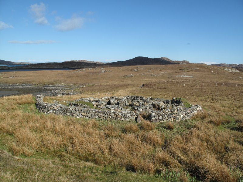 General view of the excavated and consolidated wheelhouse at Grimsay, surrounded by a modern dyke, facing east.