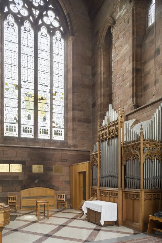 General view of organ and WC cubicle in North transept.