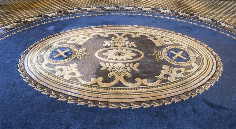 Ground floor. Detail of carpet crest in the 'Big Room'.