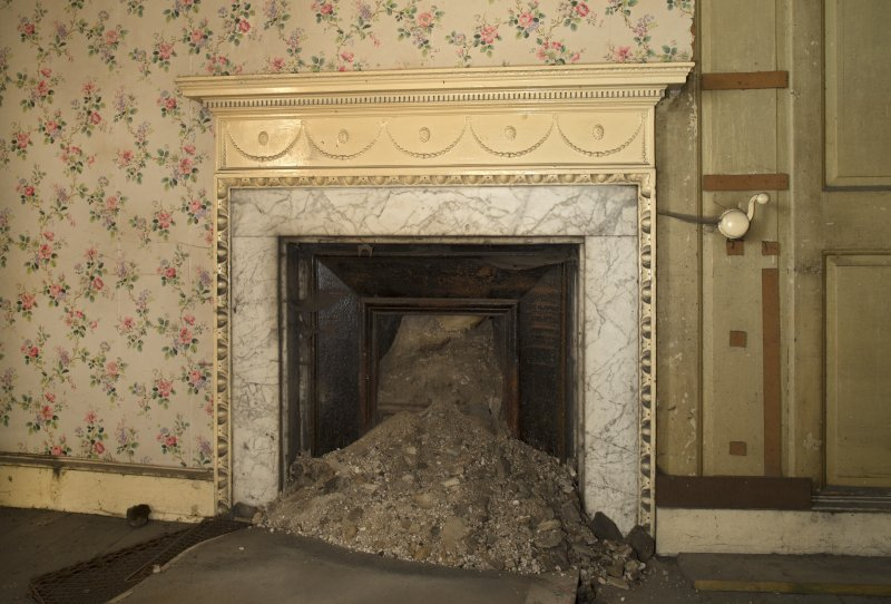1st floor, south west bedroom, detail of fireplace