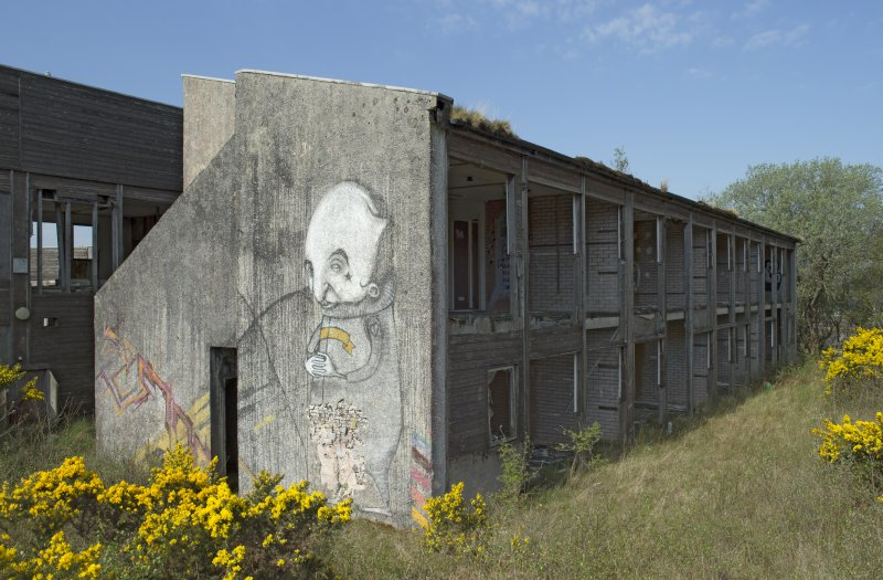 View of graffiti art by Derm, Timid and Stormie Mills on gable end of accommodation block, taken from the east.