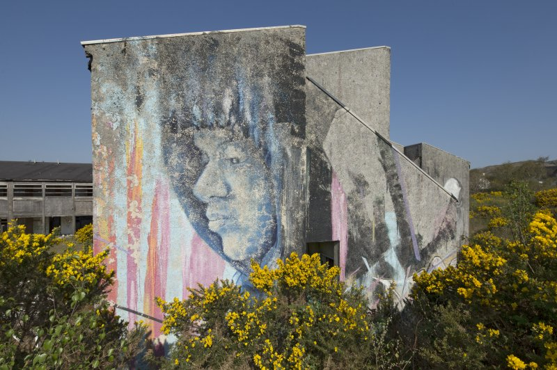 View of graffiti art by Juice 126 and System, on the gable end of an accommodation block, taken from the east.