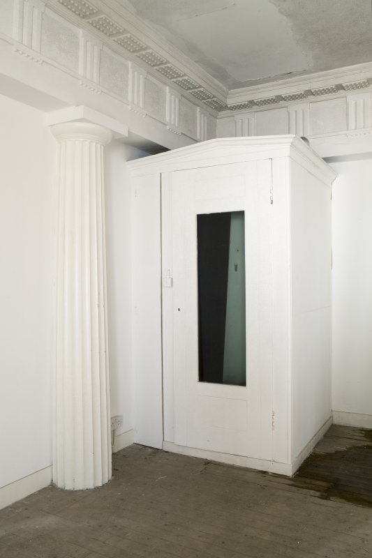 Ground floor. Central room. View of fitted cupboard in south east corner.