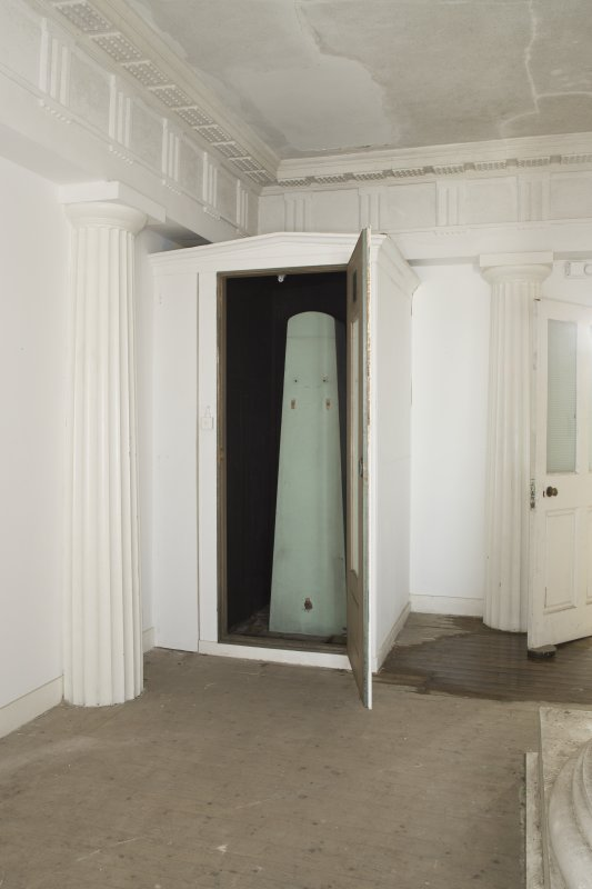 Ground floor. Central room. View of fitted cupboard in south east corner with door open.