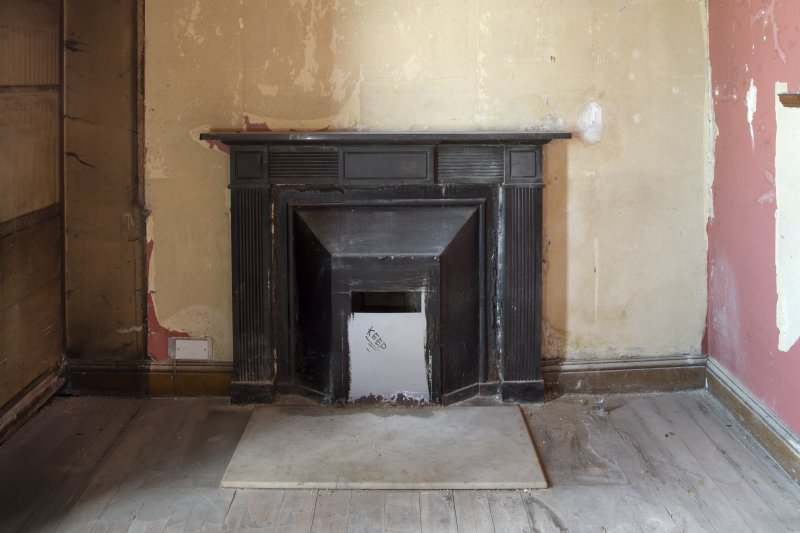 Ground floor. North room (library). Detail of fireplace.
