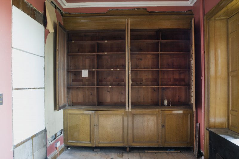Ground floor. North room (library). Detail of bookcases. Doors open.